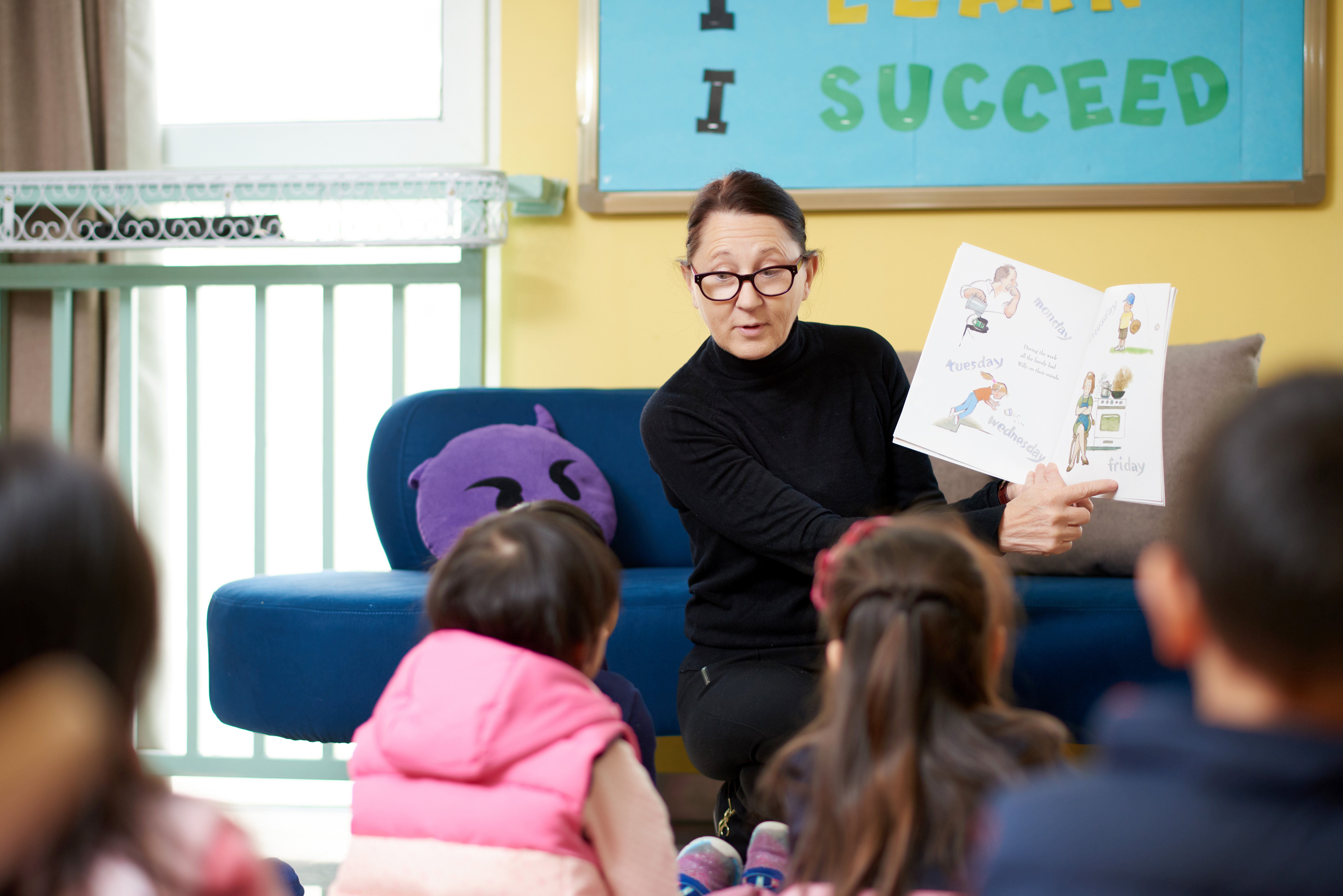 Our Librarian reading to children